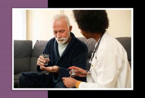 Elderly man being given daily medicine